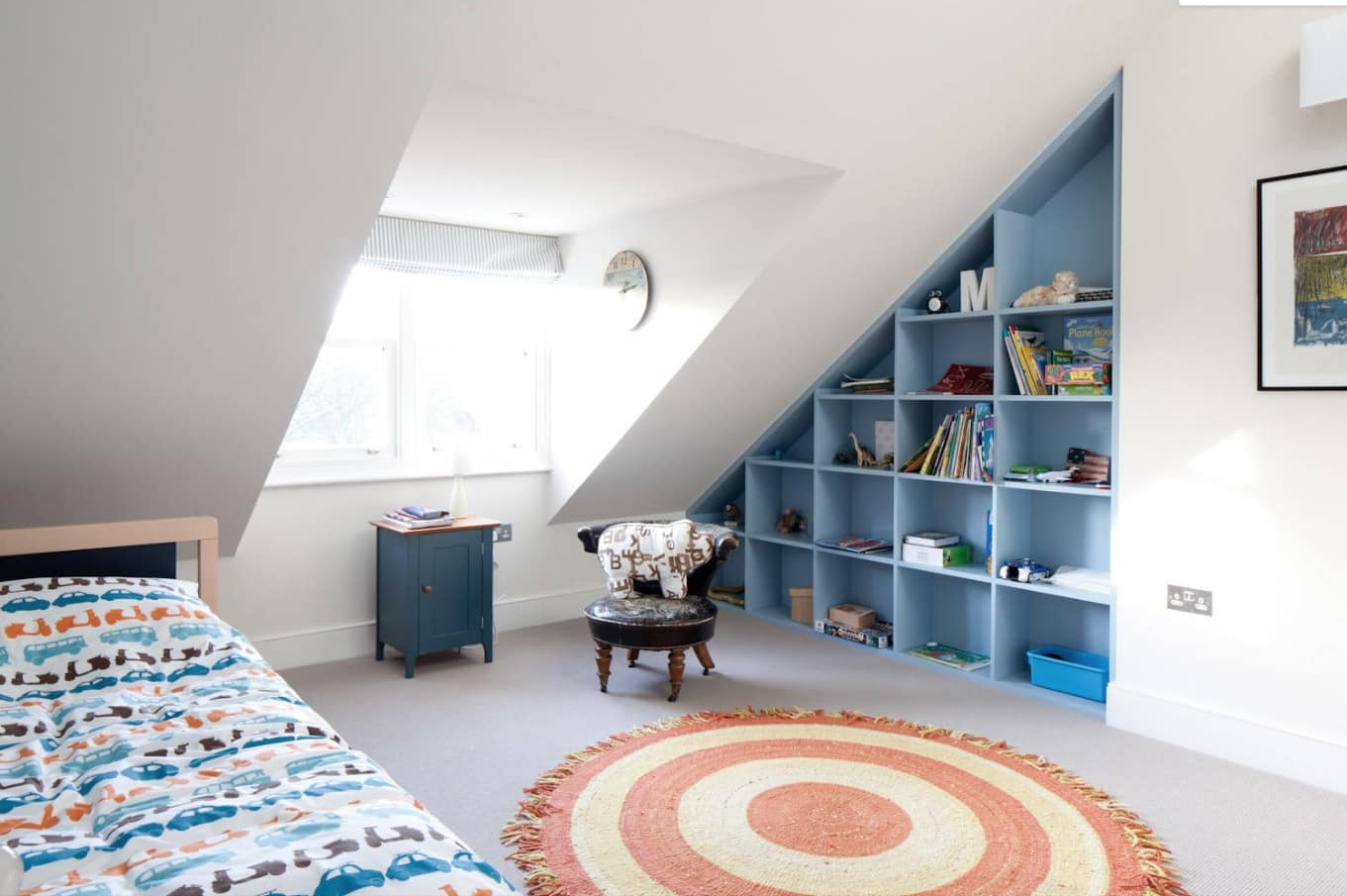 8 Best Loft Conversion Ideas for 2020. Gorgeous kids room with open storage in blue