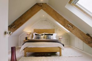 8 Best Loft Conversion Ideas for 2020. Chic lof bedroom with exposed wooden beams