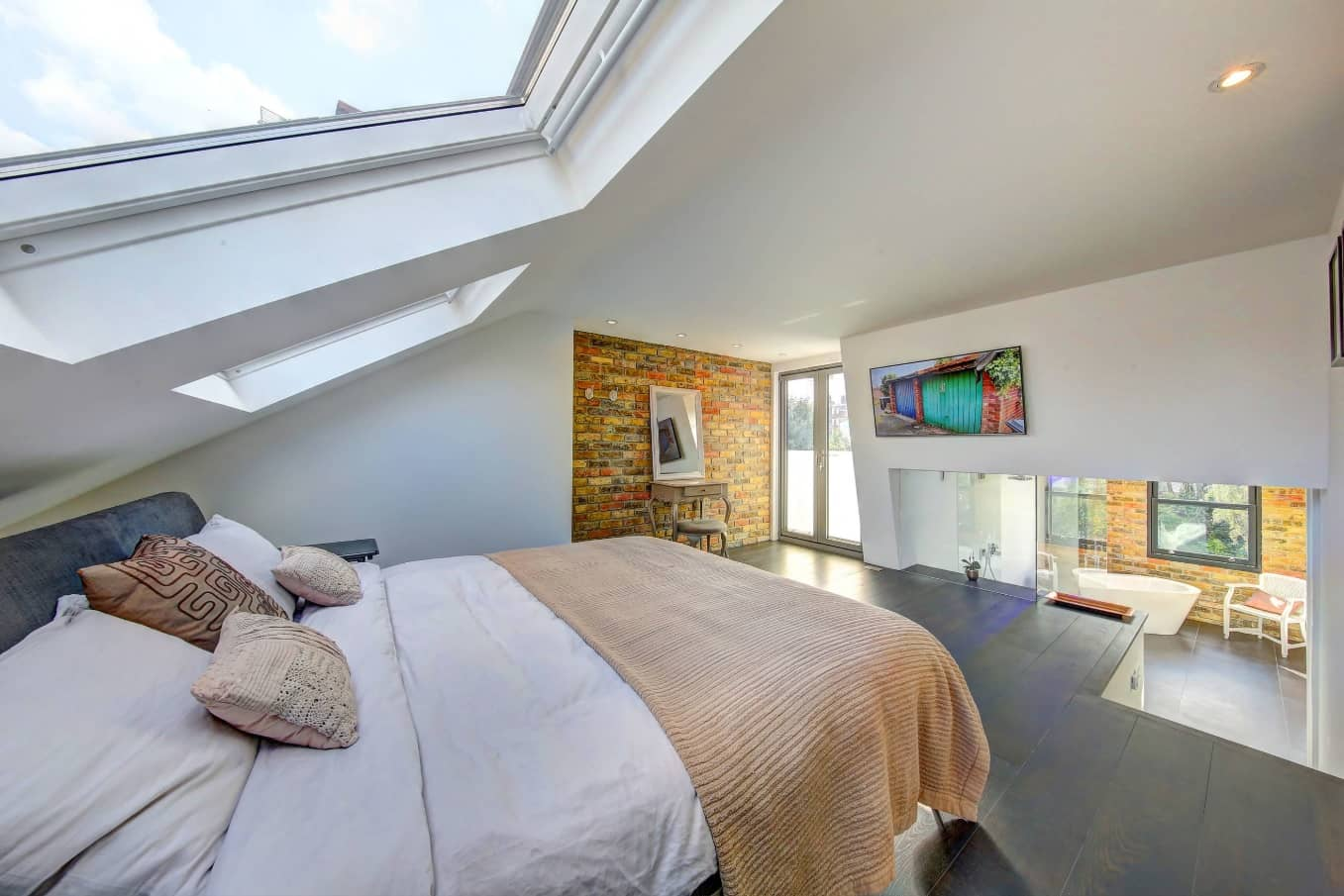 Unusual use of skylight and top pedestal bedroom zone