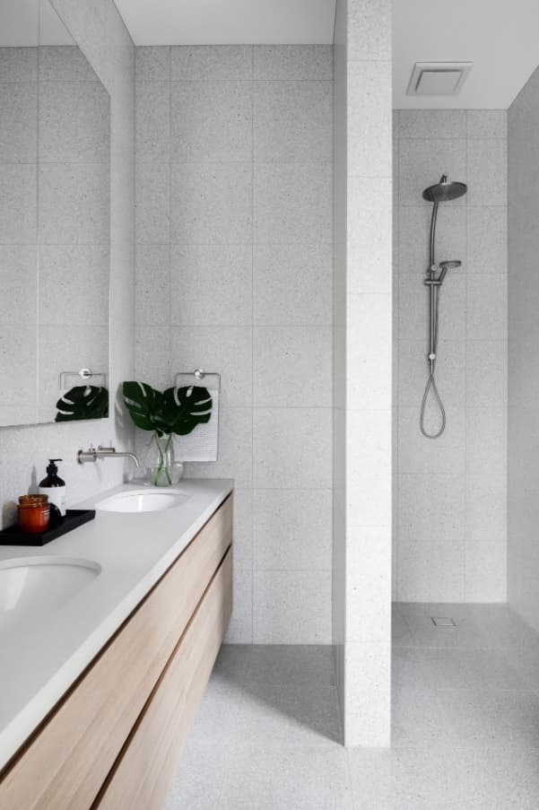 Small casual bathroom with stylish vanity and handheld shower