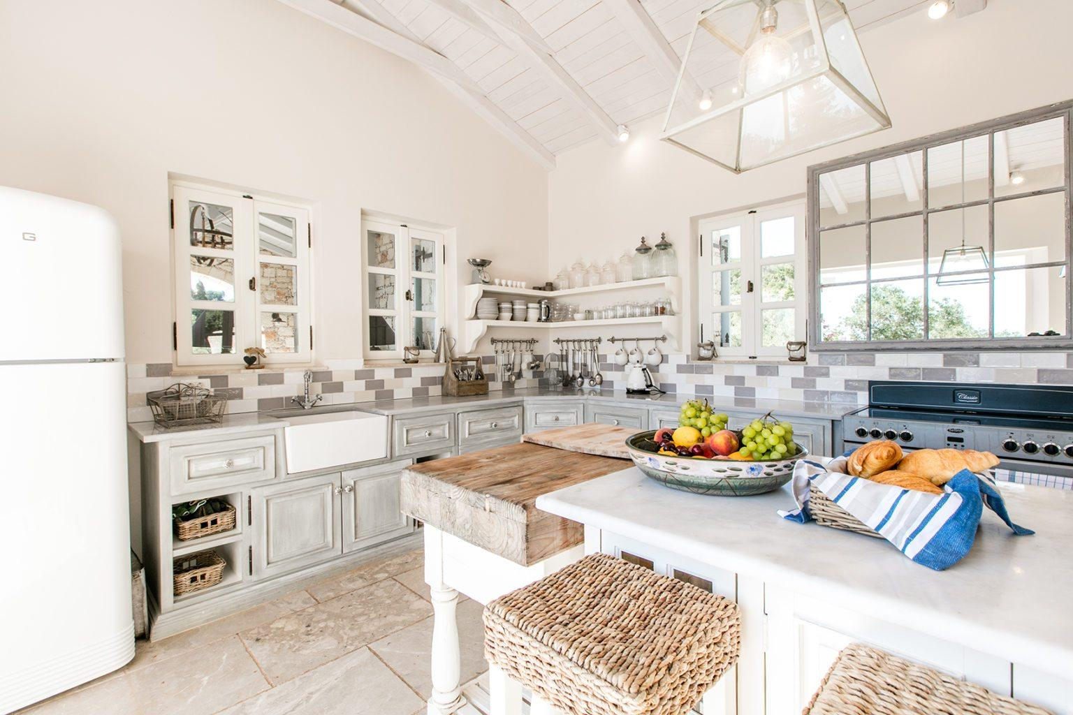 Conservative kitchen design with high wooden stools at the island
