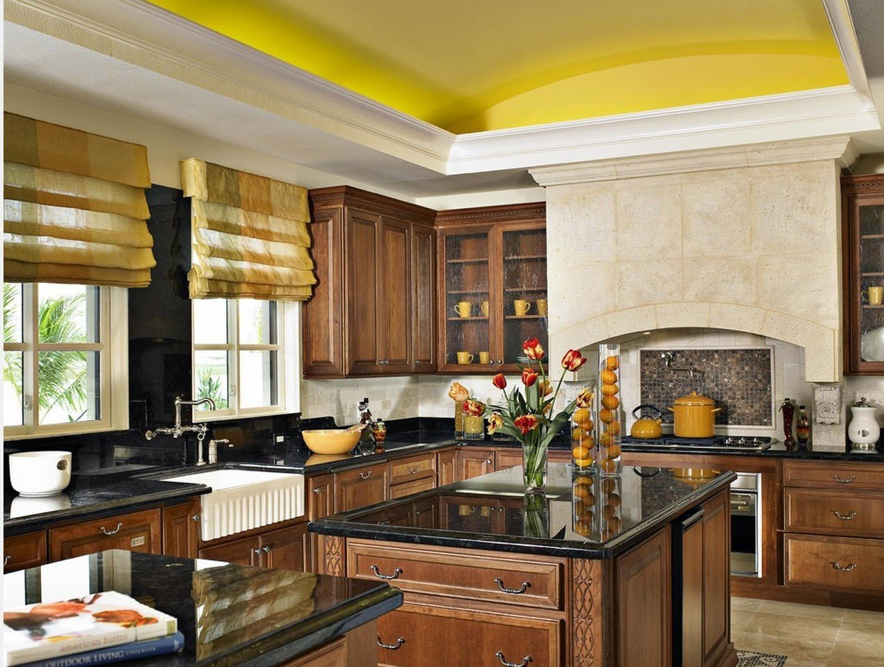 Yellow ceiling and noble dark wood for furniture in the Classic kitchen