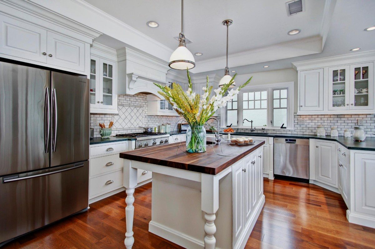 White modern colonial kitchen with carved facades