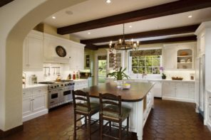 Colonial Style Kitchen as Distinctive Feature of Chic Interior. Ethnic minimalism with exposed dark ceiling beams