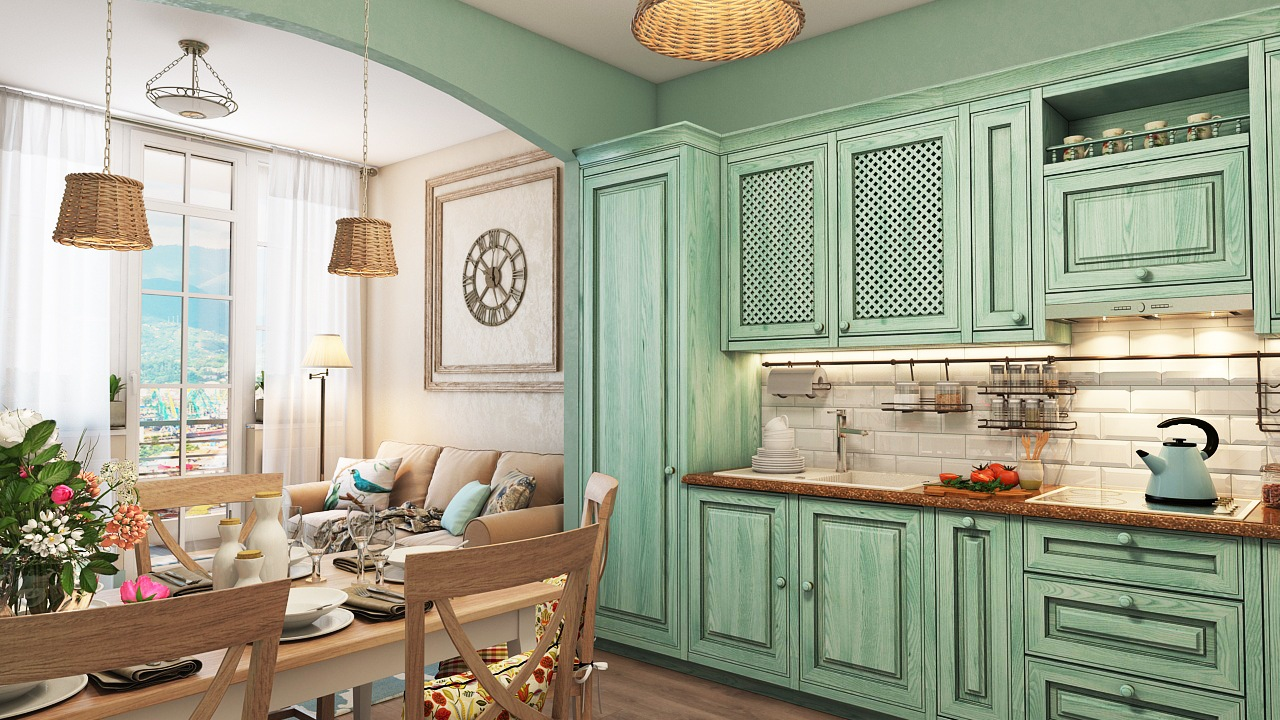 Emerald green furniture and decoration elements of the Greek styled kitchen