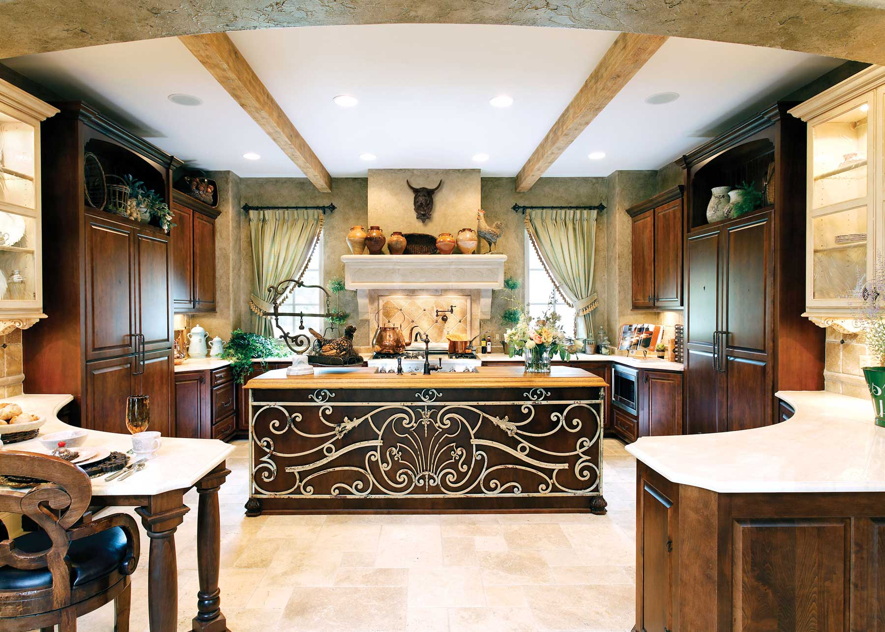 Chic painted and carved island of the ethnic styled kitchen