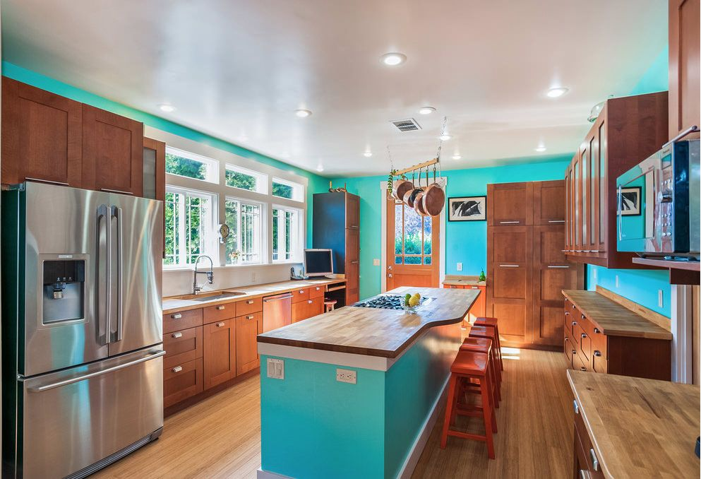 Stretched ceiling as unexpected decision in classic turquoise kitchen with light wooden floor