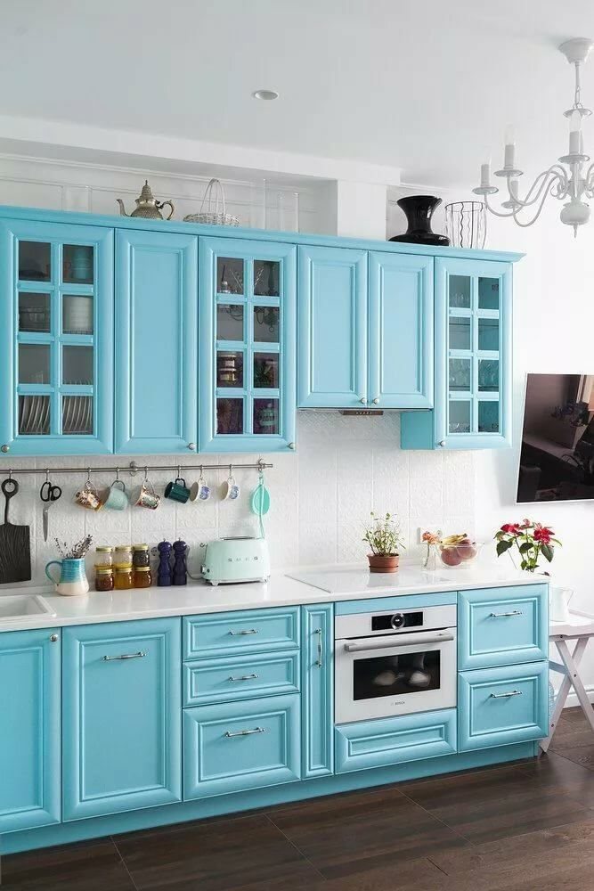 Sky blue kitchen furniture set and white painted walls
