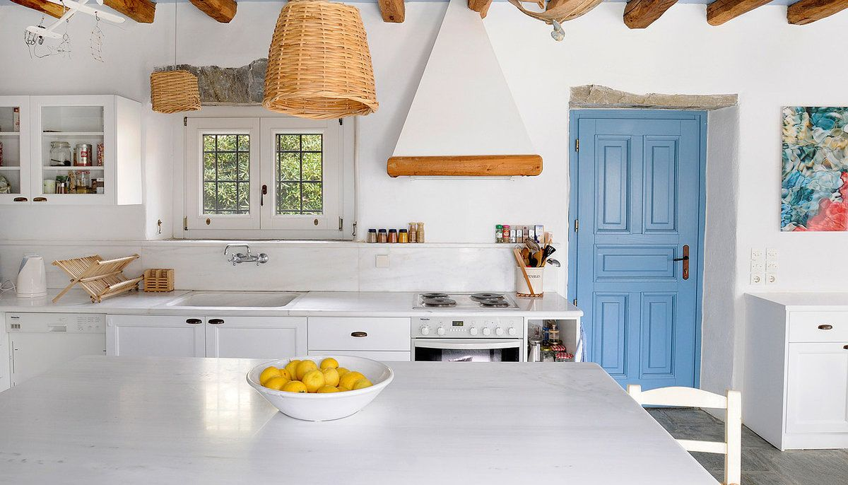 Greek Kitchen Interior Design Style: Harmony of Simplicity. A little bit of provence added with the wooden trimmed extractor hood