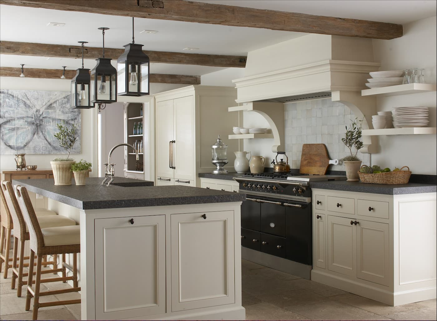 Typical classic interior of the kitchen in white with dark countertops