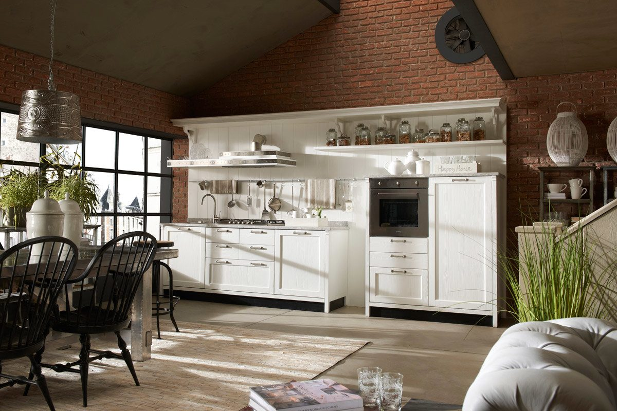 Casual styled kitchen with white furniture set
