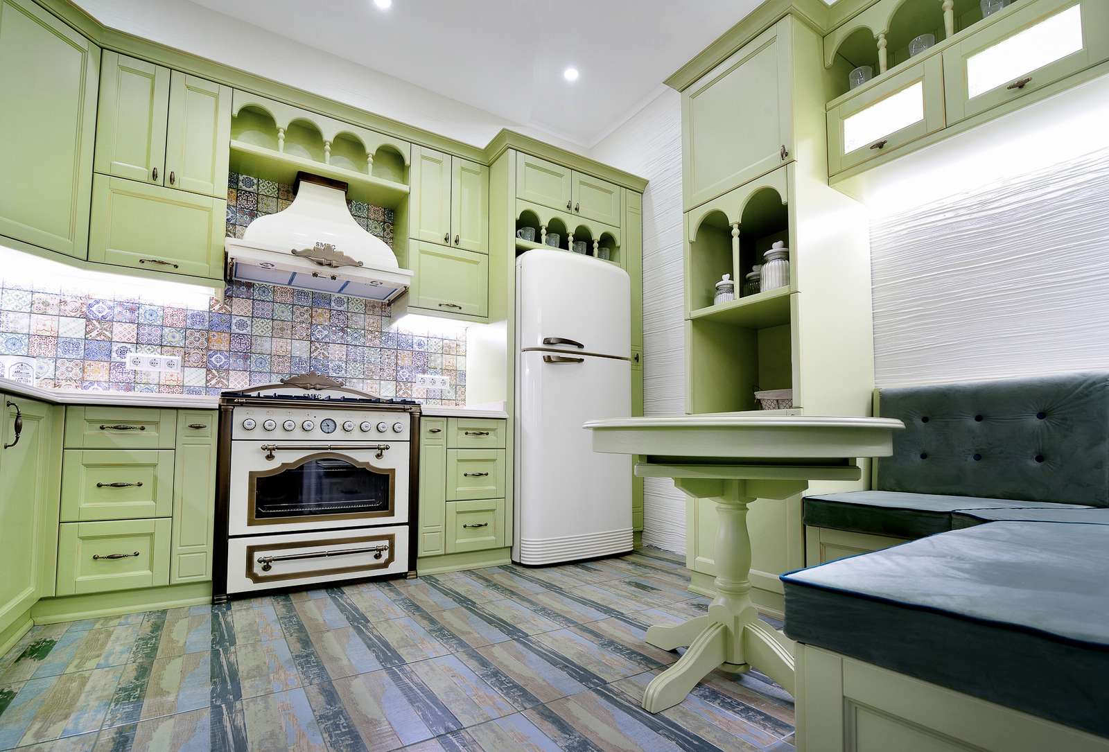 Olive colored Greek kitchen with arched hung cabinets