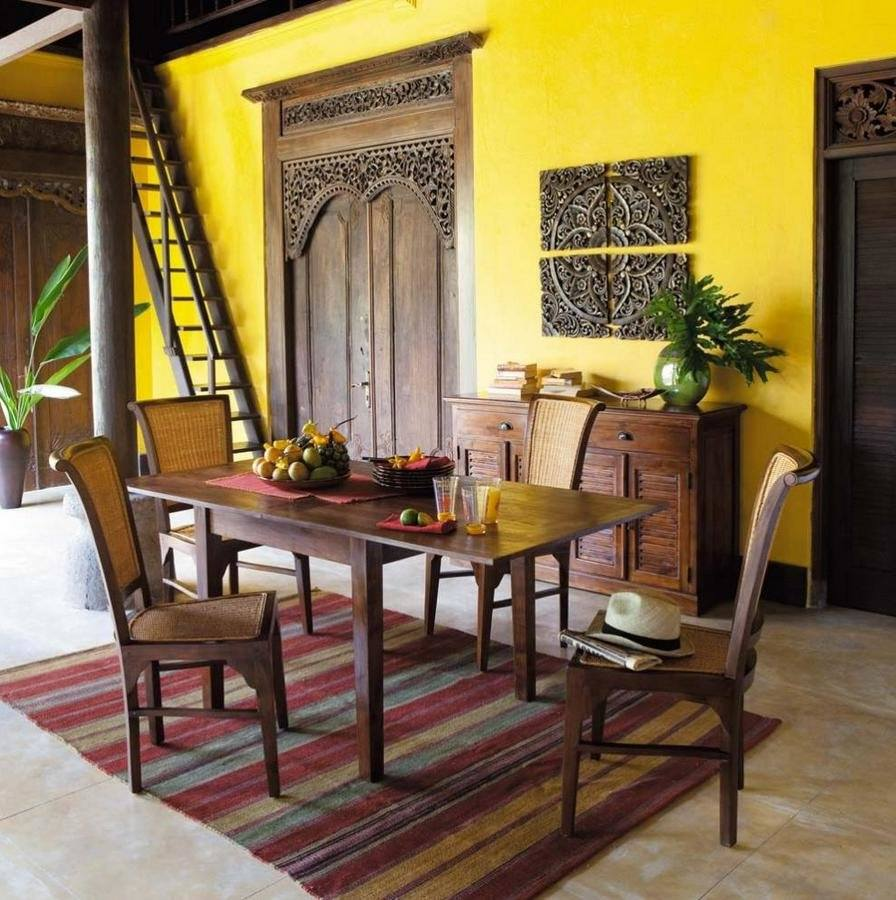 Yellow accent wall for wooden dining set