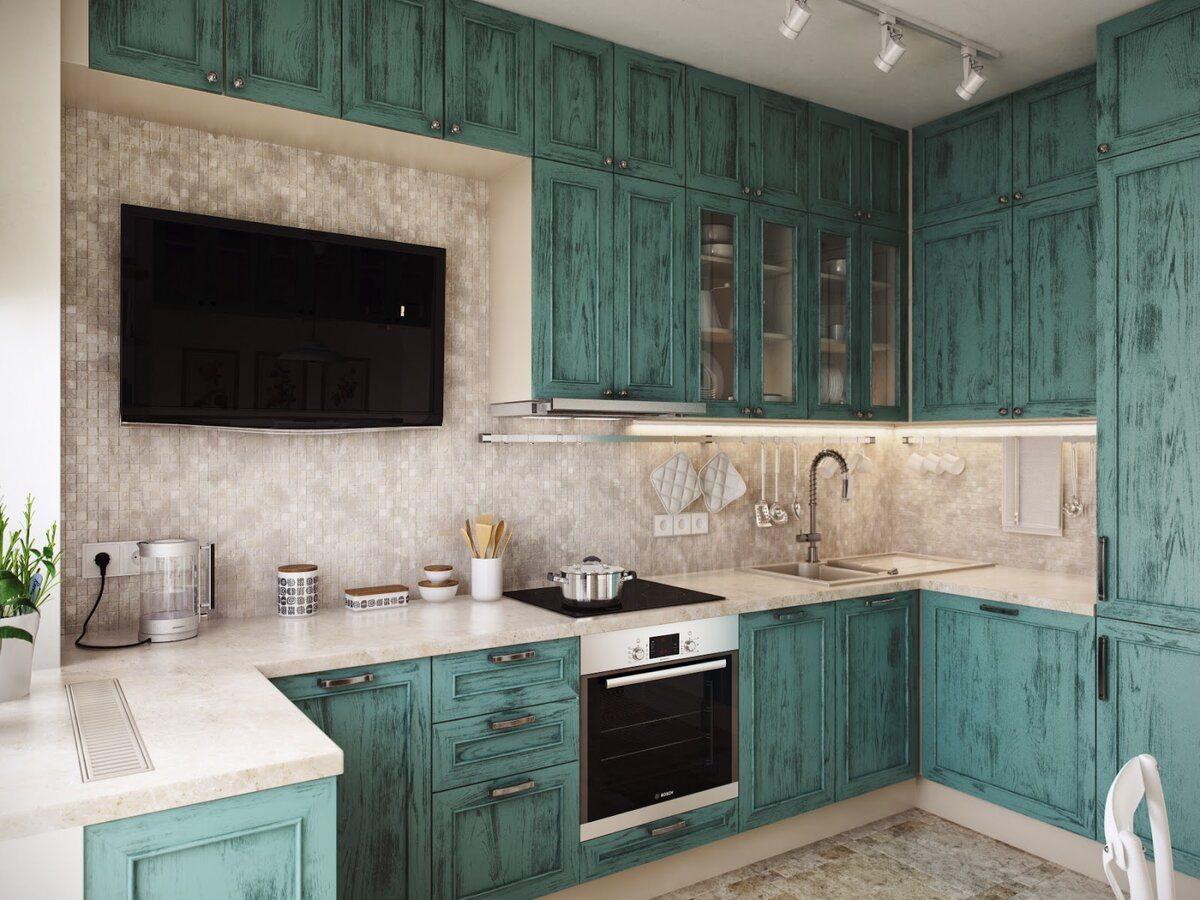 Artificially worn-out looking turquoise kitchen facadesfor classic designed kitchen with a TV