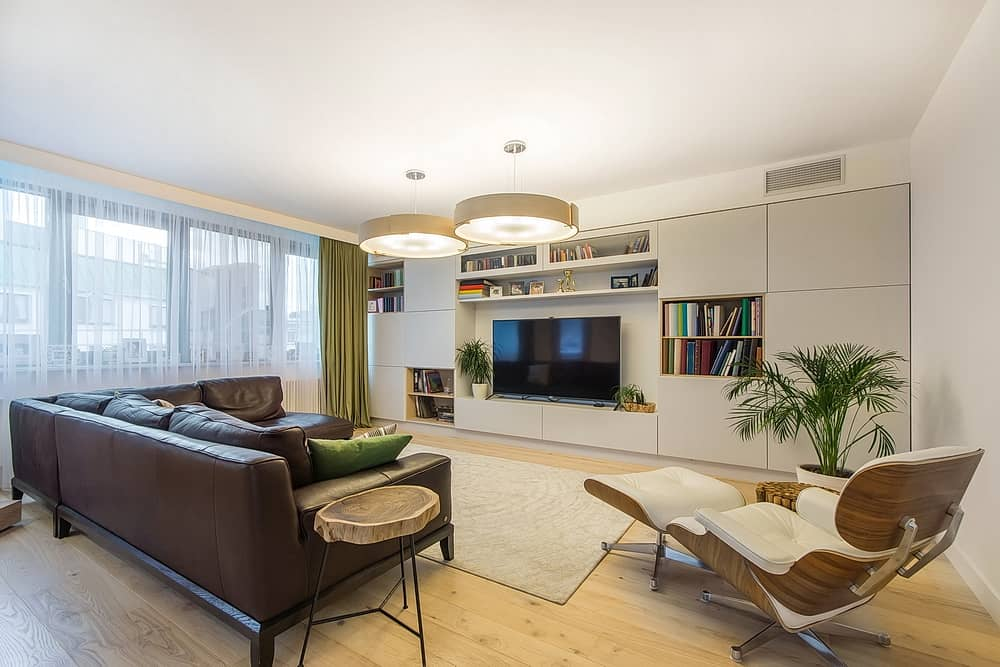 Cool apartment with TV set, a leather brown sofa and soft leather armchair