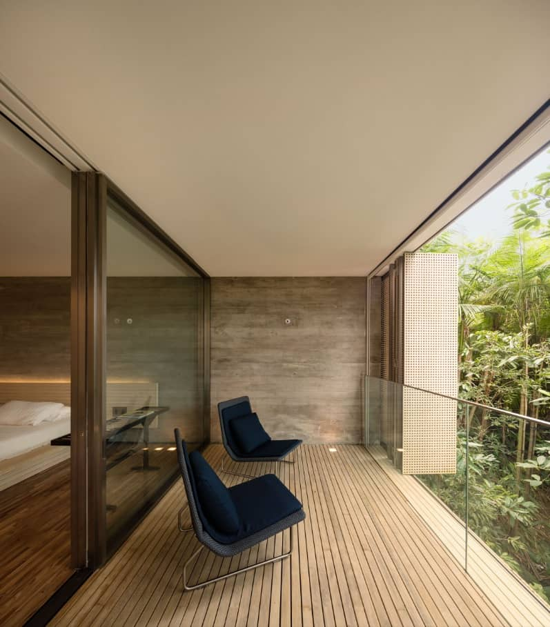5 Tips for Adding a Balcony to a House. Boxed lounge area with beige colored ceiling and wooden trimmed walls & floor
