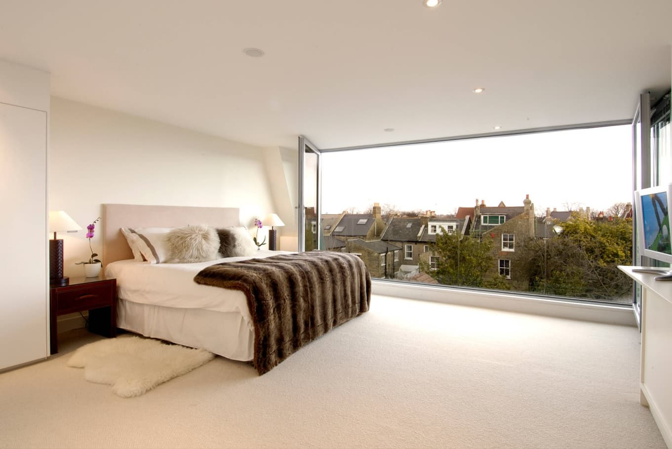 Panoramic window with a French balcony in London