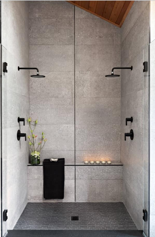 Faux concrete tile for the modern bathroom with black shower heads and plumbing accessories