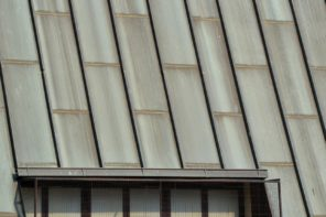 The Pros and Cons of Corrugated Roofing. Small window built into the roof
