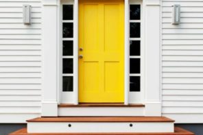 Simple house exterior design with yellow classic front door