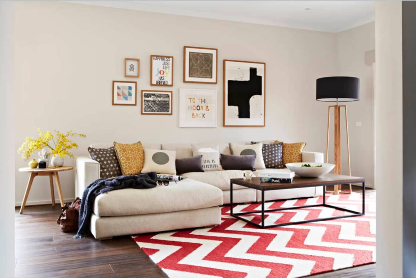 How to Decorate a Living Room on a Budget. Wavy colorful rug and the pictures to revive the atmosphere