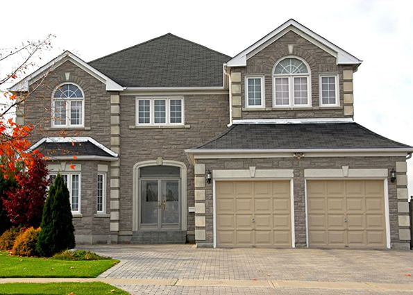 Modern sectional house in classic American style with double garage and stone finishing