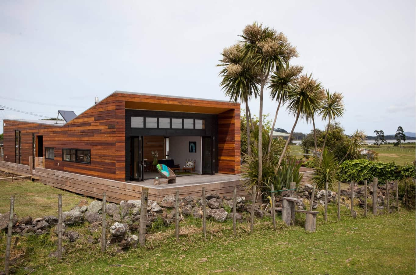 Wooden trimmed modern cottage at the rocky foundation