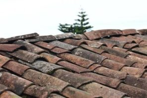 Signs That Let You Know It's Time For Your Roof to Be Repaired or Replaced. Old crooked shingle roof