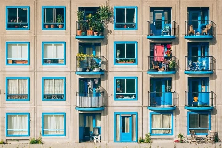 Getting The Most Out Of Your Small Balcony. Typical apartment house with blue colored balconies