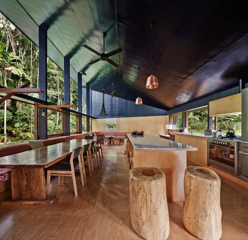 Stylish and Effective Sustainable House Designs to Inspire. Black ceiling, large space and wooden stumps as chairs