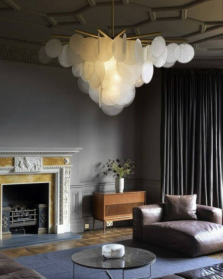Dark color palette for classic room with suspended plastic circles creating monolith composition