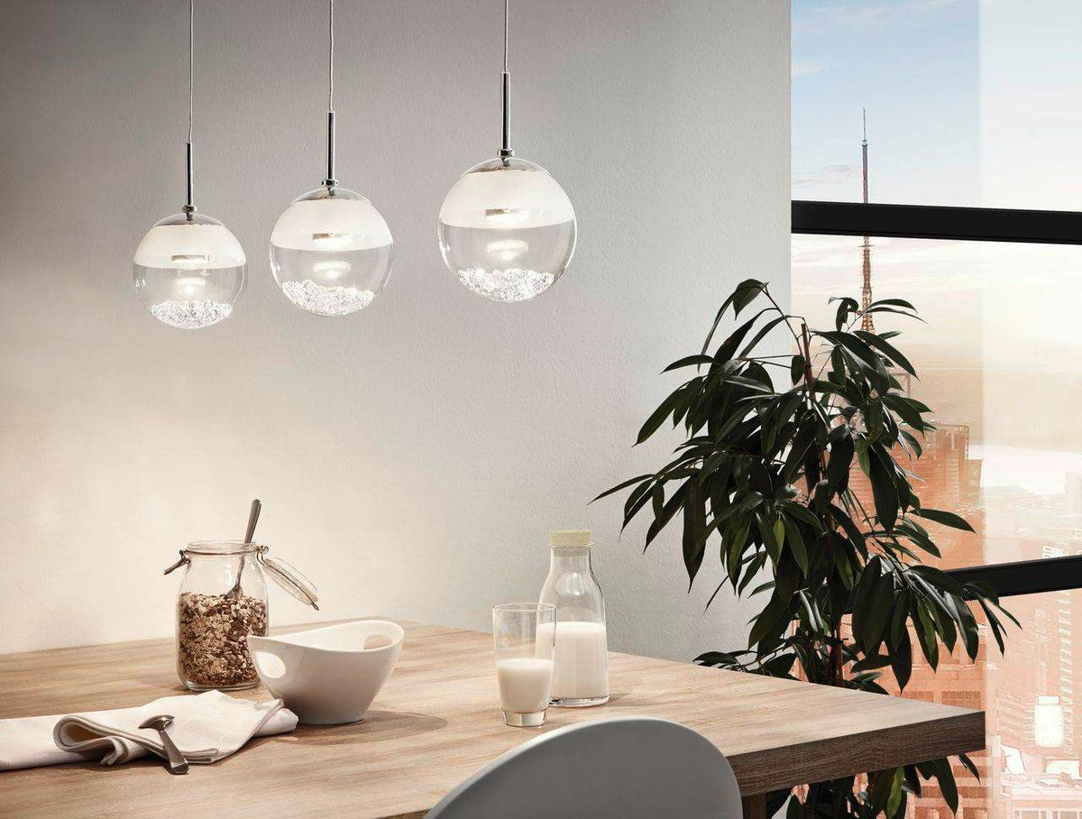 Minimalist Scandinavian design with round lamps over the dining room