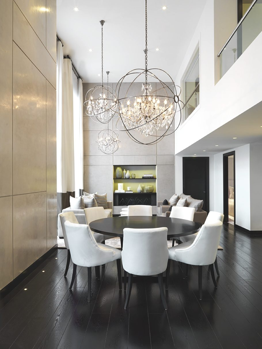 Black metal globe candly style chandeliers for large dining zone in the double ceiling with black floor and table