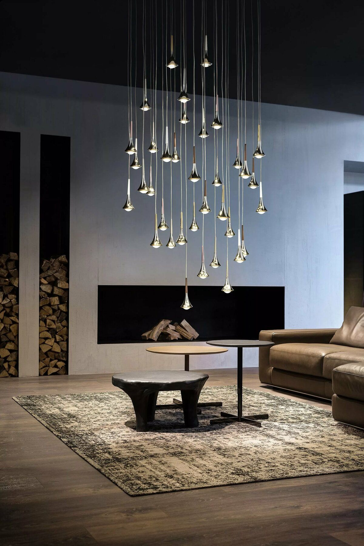 Modern waterfall glass and crystal lights for ultramodern designed living with built-in fireplace and firewood storage