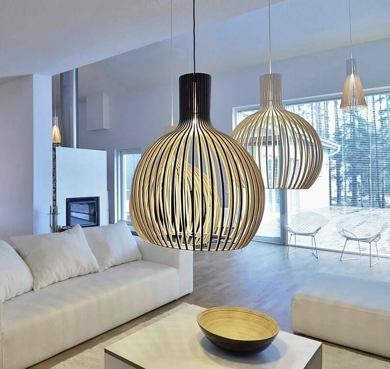 Metal rods shade for lamps over the coffee table in the modern living room