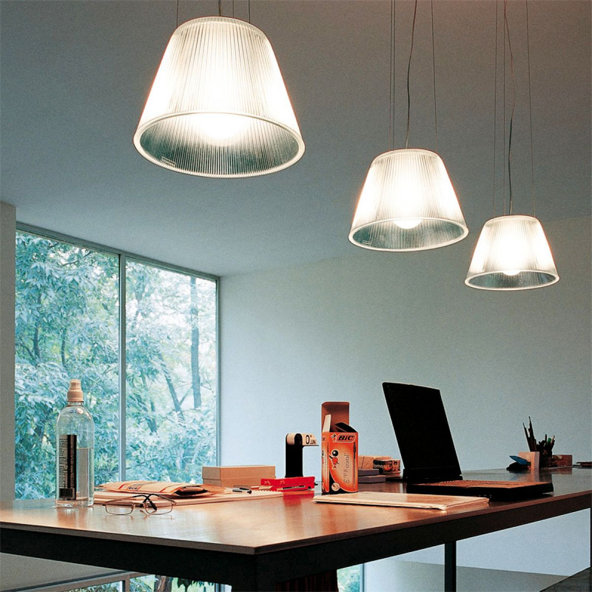 Dining room with simple lamps over the wooden table