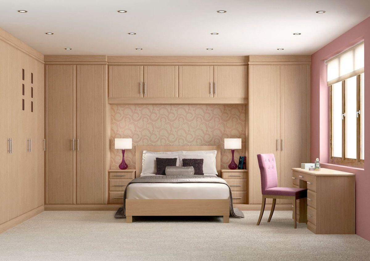Soft designed bedroom with light wooden furniture set having top level of drawers