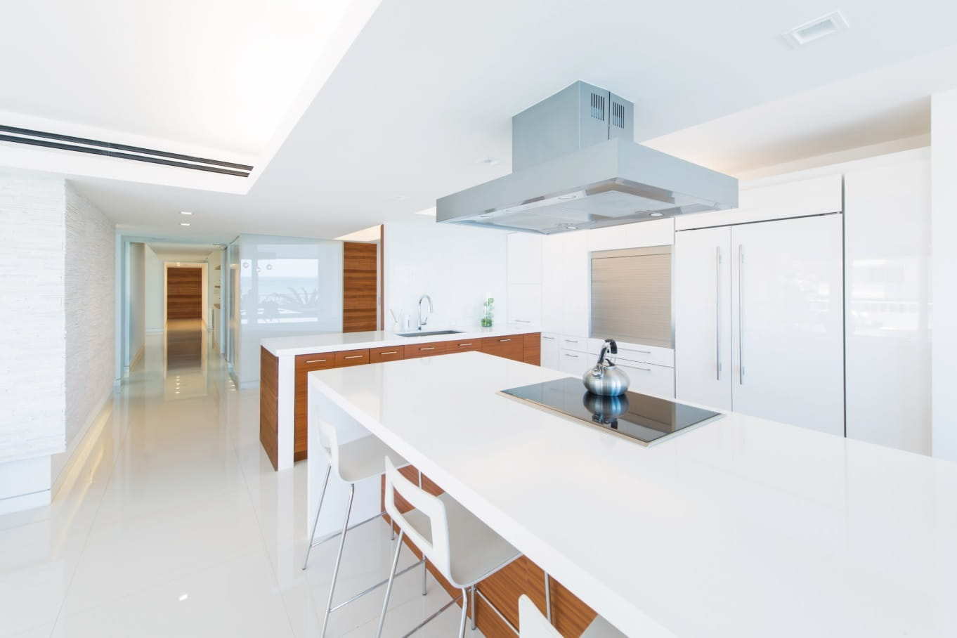 The Go-Getter's Guide to Hiring a Sustainable Architecture Expert. Great modern design for glossy facaded white kitchen