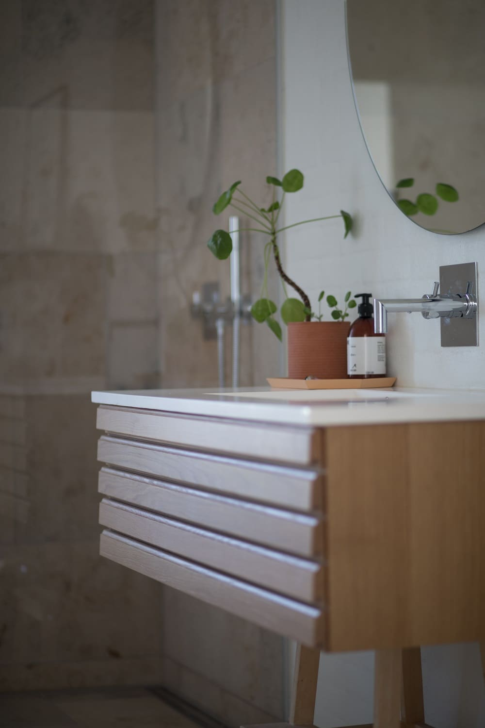5 Reasons Why Timber Vanities are Best for Your Bathroom. Hovering vanity and the plant to decorate small space