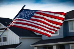 How to Hang an American Flag: The Complete Homeowner's Guide. Flying flag in front of the house