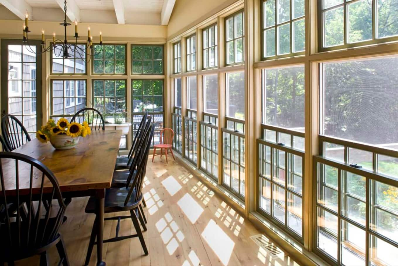 Let in the Light! 7 of the Best Window Styles to Consider for Your Home. Large dining room in the wooden trimmed natural lit room