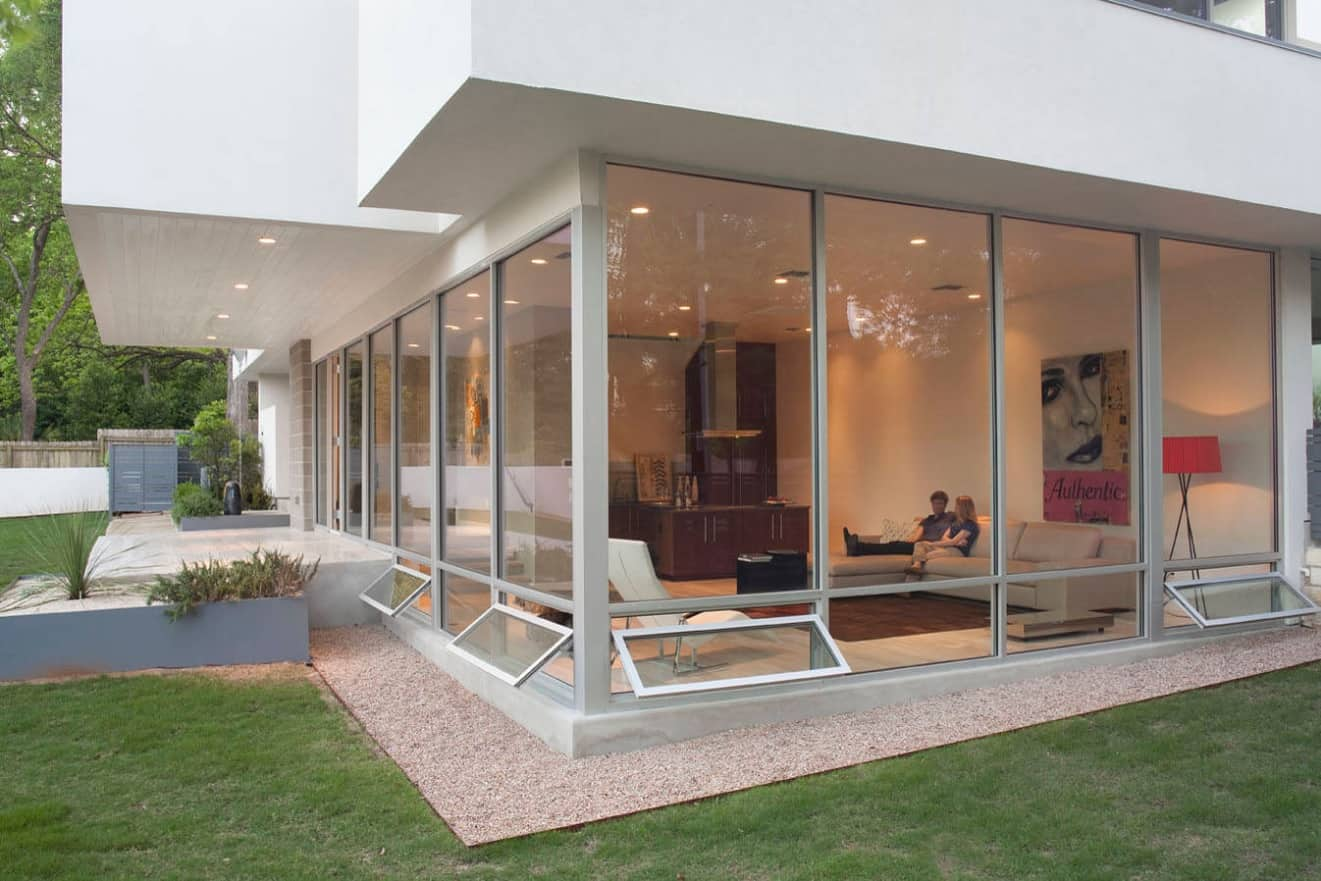 Bottom opening panoramic windows for modern white colored house