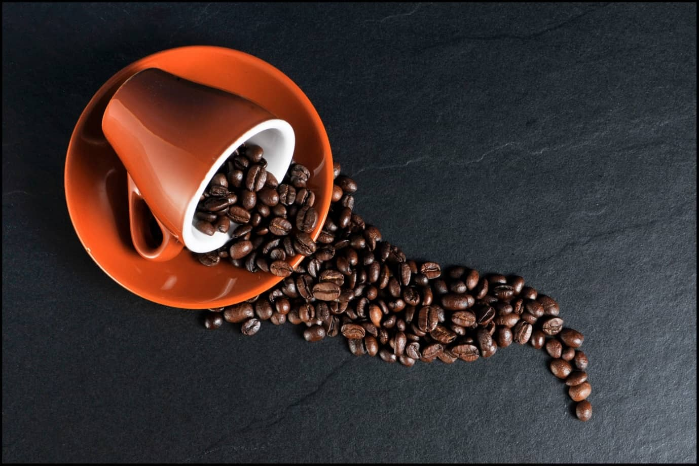 This Is What You Need to Do If You Spilled Coffee on Your Carpet. The cup full of coffee grains