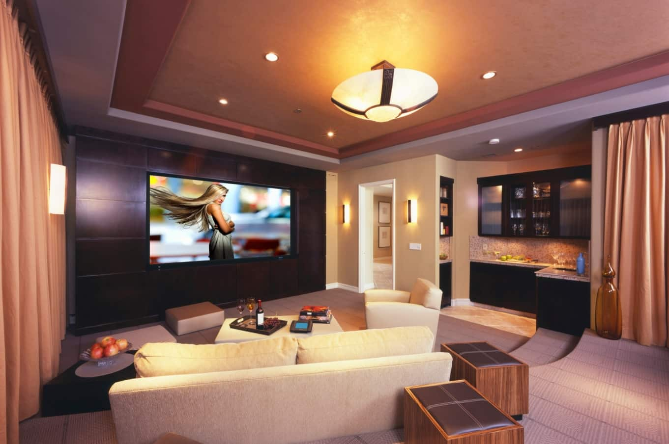 5 Home Theater Tips Other Than Getting a Kicking Projector. Living room theater with large TV screen and relaxing zone
