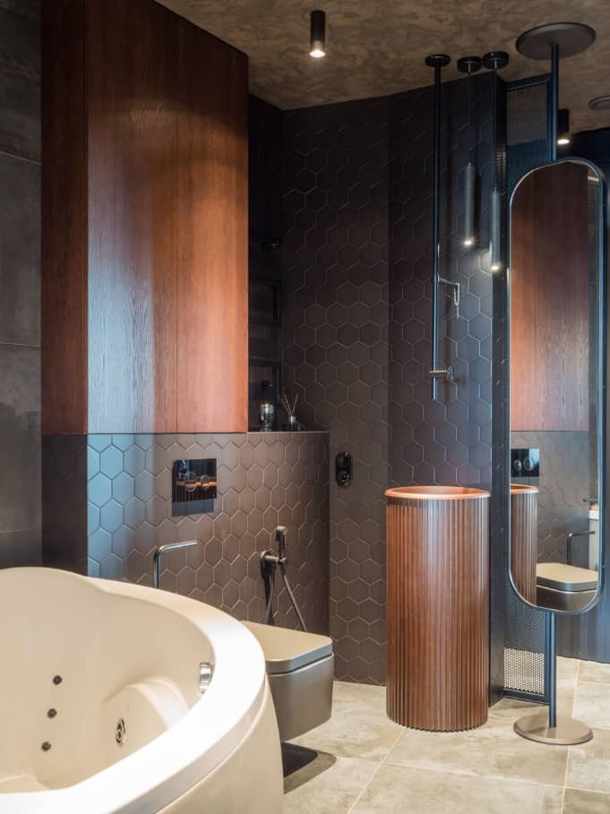 8 Tips For Keeping Your Interiors Picture Perfect. Dark chocolate octagon tiles and dark wooden bathroom trimming