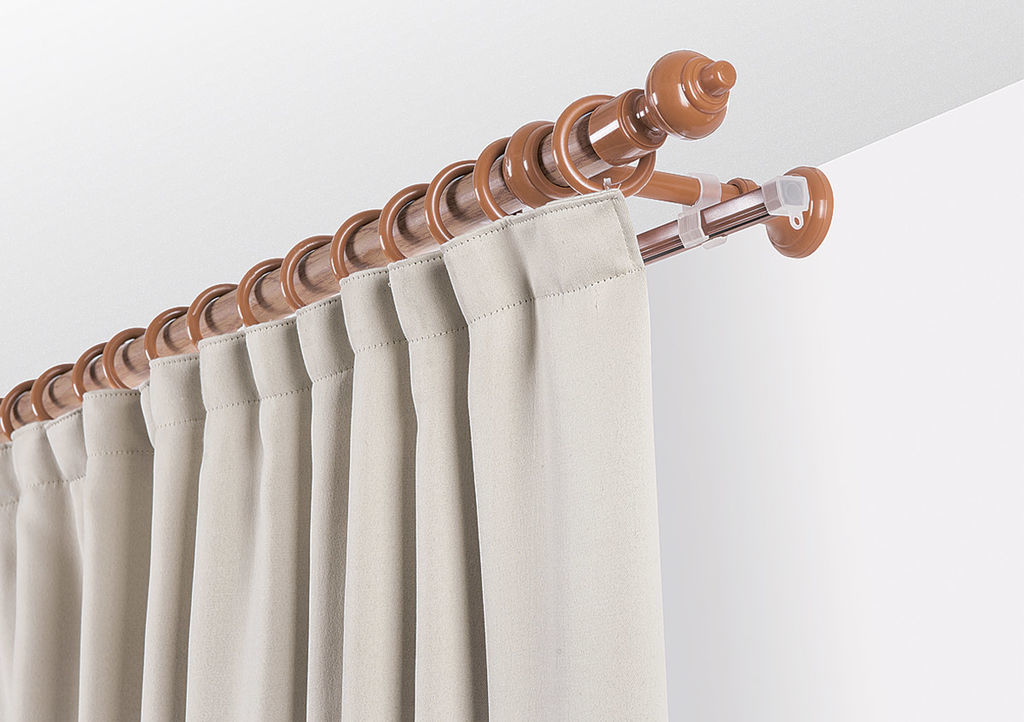 Beige curtain rod and fastening rings