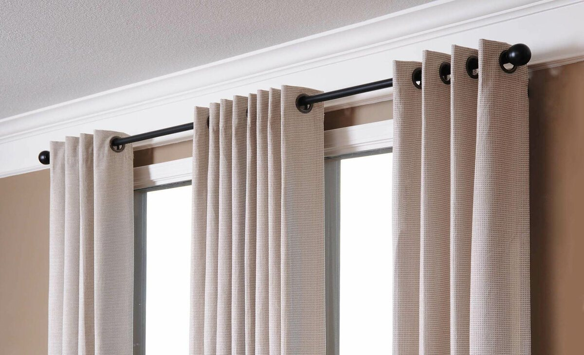Simple design of black curtain rod and ring mounted drapes