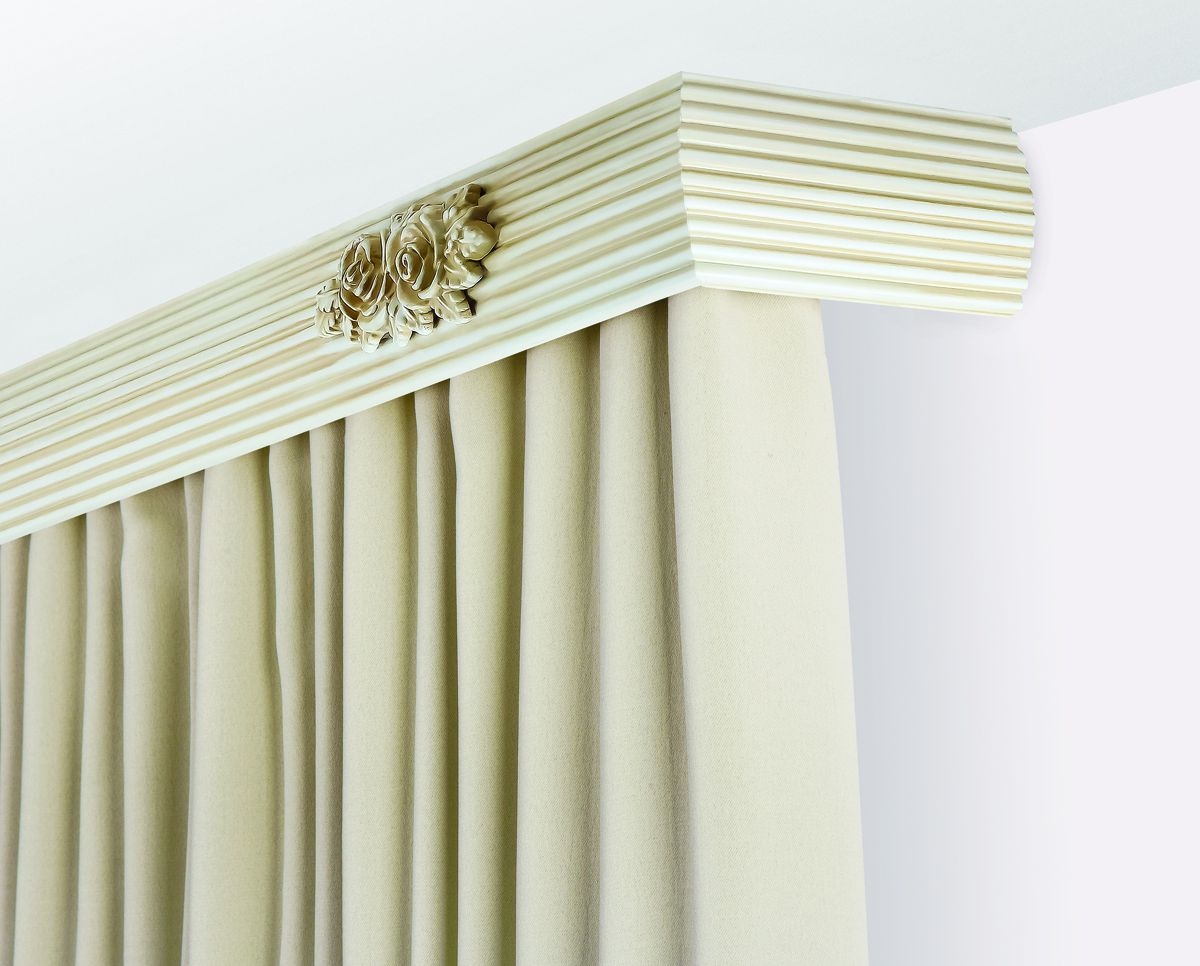 Angle cornice with pastel colored cutain