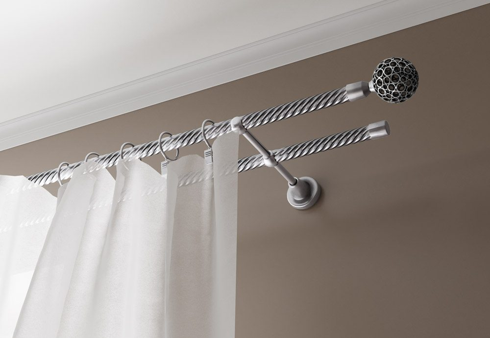 Curtain Rods: Types, Production Materials, Fastening Overview. Twisted steel double curtain rod at the backdrop of the grey wall
