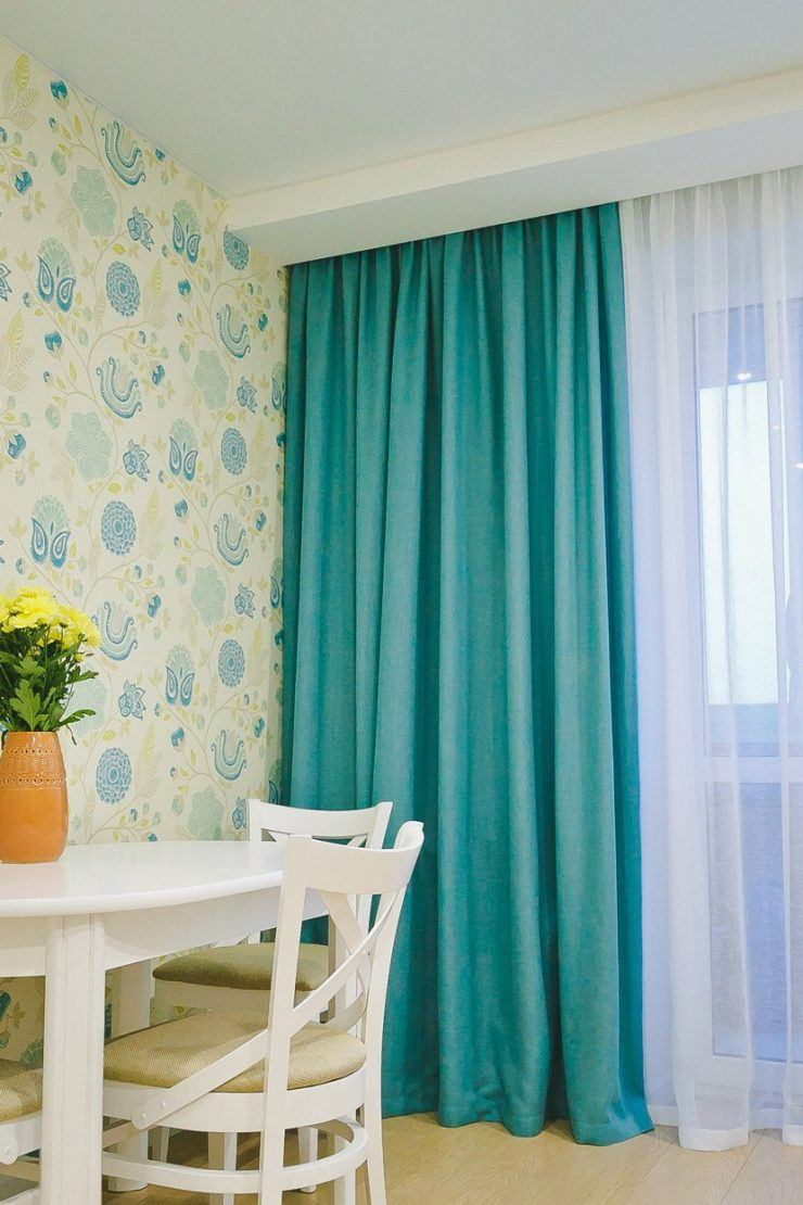 Curtains Rods: Types, Production Materials, Fastening Overview. Turquoise curtains and dotted wallpaper for calming down atmosphere